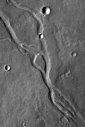 Although they look somewhat like streambeds, these channels near the volcano Elysium Mons were carved by molten lava. The flow was from upper left to lower right. (NASA/JPL-Caltech/Arizona State University)