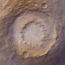 Lowell Crater, 202 kilometers (126 miles) across, is a typical peak-ring crater. These form when the impact is big enough to blast a crater at least 100 km (60 mi) wide. Instead of a single central peak, they develop a ring of peaks, hence the name. (NASA/JPL-Caltech/Malin Space Science Systems)