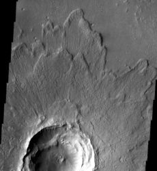 Many craters, including this 7 km (4.3 mi) one, have ejecta sheets with upraised outer rims. These form when the flying debris abruptly stops and material piles up behind it. The radial lines on the ejecta surrounding the crater rim come from superheated gas and debris surging outward after the impact. (NASA/JPL-Caltech/Arizona State University)
