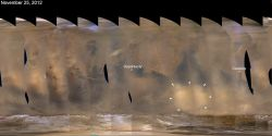 White arrows indicate a November 2012 regional dust storm on Mars, along with the positions of the Opportunity and Curiosity rovers in different parts of the planet. (NASA/JPL-Caltech/Malin Space Science Systems)