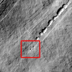 A line of collapsed pits traces the path of a lava tube on the giant volcano Pavonis Mons on Mars. In the red box is a round dark spot — a lava tube skylight discovered by a Mars Student Imaging Project class of 7th graders. (NASA/JPL-Caltech/Arizona State University)