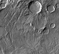 "The branching channels of Warrego Valles offer evidence it once rained on Mars. The pattern, called ""dendritic"" (tree branch-like), branches in the same way as do streams on Earth caused by rainfall. But dendritic channel patterns are relatively rare on Mars. If it rained there, it probably wasn't very often — or for very long. (NASA/JPL-Caltech/Arizona State University)"